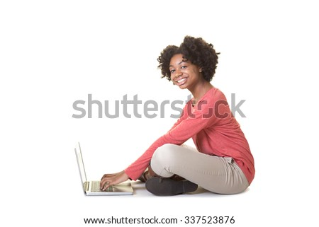 A teenage girl working at a computer - stock photo