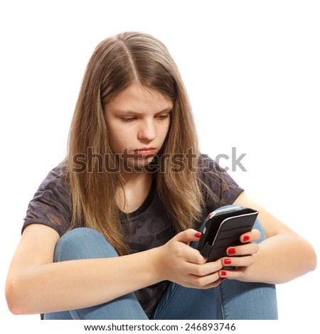 A teenage girl working with her smartphone - stock photo