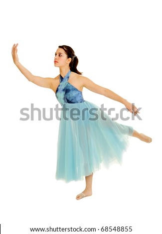 A teenage lyrical dancer softly poses