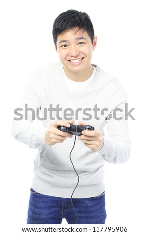 A teenager playing a video game  - stock photo