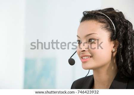 A telephone operator talking into a mic