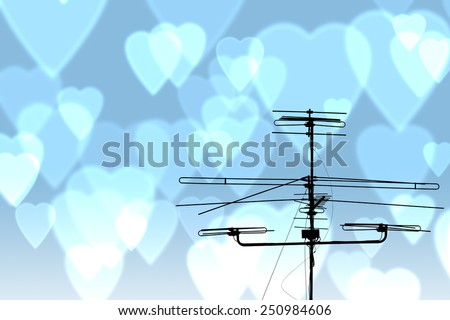 A television antenna on blue heart background: sign of love connection - stock photo