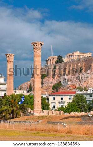 A Temple of Olympian Zeus and Acropolis with Parthenon in the background , Athens , Greece .