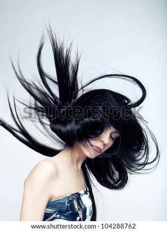 A tender portrait of a dreamy girl with eyes closed, and the developing hair - stock photo