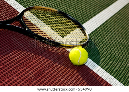 A tennis ball and racquet