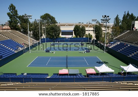 A tennis court on a college campus