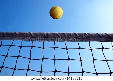 a tennis net and a ball - stock photo
