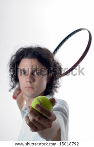 A tennis player ready to serve the tennis ball. Vertically framed shot - stock photo