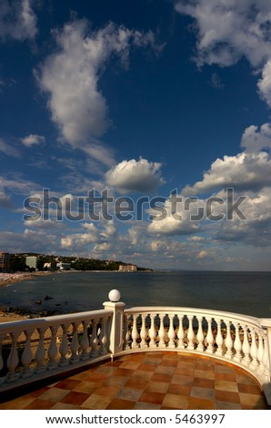 a terrace with sea and cloudy sky - stock photo