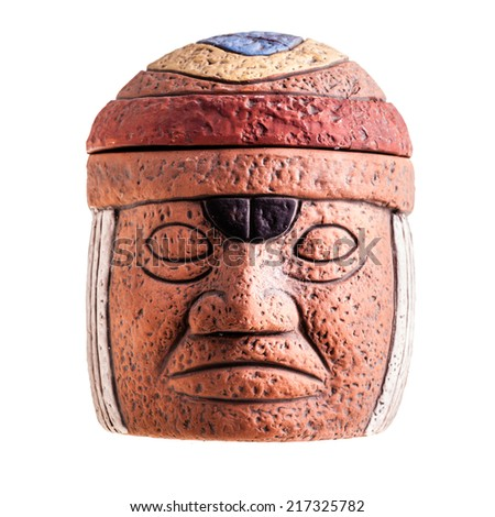 a terracotta olmec face idol souvenir isolated over a white background - stock photo
