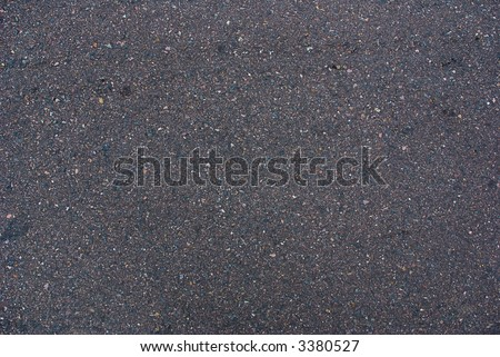a texture or background image of a black tar asphalt road surface made of bitumen.