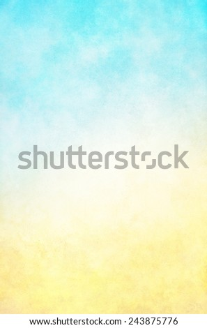 A textured fog and cloud background with a bright, high-key blue to yellow gradient.  Images displays a paper grain and texture at 100 percent. - stock photo