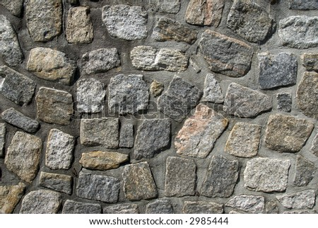 A textured stone wall provides a randomly patterned background