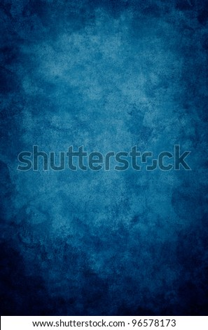 A textured, vintage paper background with a dark blue vignette. - stock photo