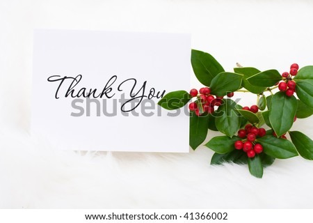 A thank you card with holly and berries on a white fur background, thank you card - stock photo