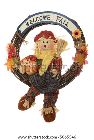 A Thanksgiving wreath with scarecrow isolated over white - stock photo