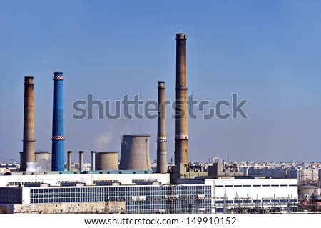 A thermoelectric power station with smoking chimneys.