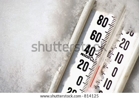 a thermometer in snow - stock photo