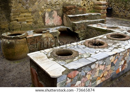 A thermopolium in Herculaneum (near Naples, in Italy), an antique fast food restaurant - stock photo