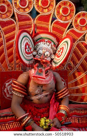 A Theyyam dance performer. Theyyam  is a unique artform of north Kerala in India