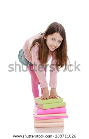A thin girl schoolgirl put his hands on a stack of textbooks-Isolated on white background - stock photo