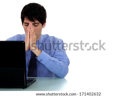 A thinking businessman at his desk. - stock photo
