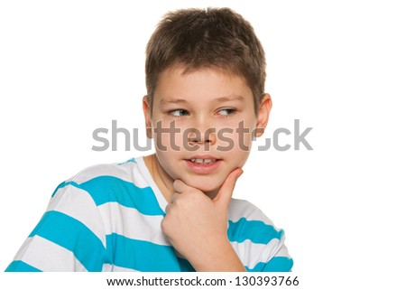 A thoughtful boy looks aside on the white background - stock photo