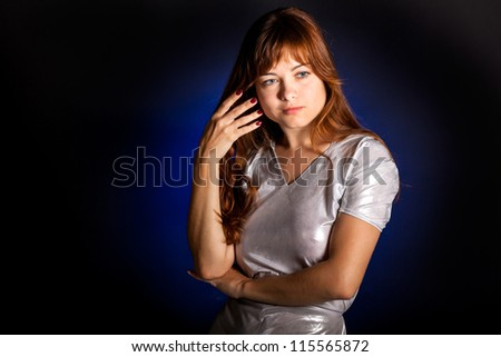 A thoughtful young woman in studio - stock photo