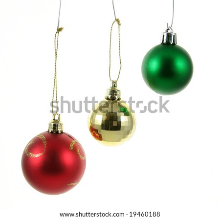A three isolated hanging Christmas baubles.