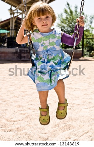 A three year old child playing. - stock photo