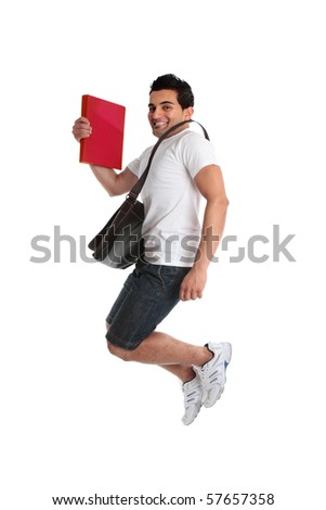 A thrilled energetic man student jumping leaping or celebrating a success, triumph or other.  White background. - stock photo