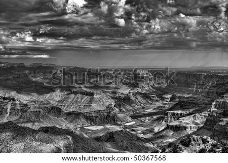 A thunderstorm approaching the Grand Canyon in black and white - stock photo