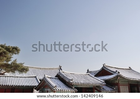 A tiled roofs and clear sky - stock photo
