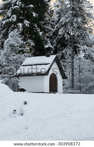 A tiny church beside a mountain road in Austria - stock photo