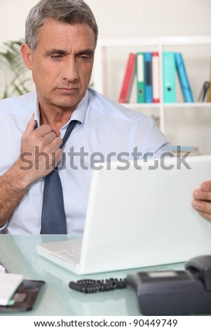 A tired corporate man. - stock photo