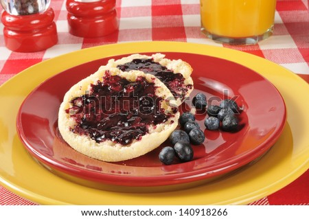 A toasted English muffin with fresh blueberry jam - stock photo