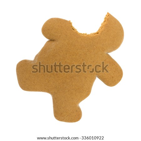 A top view of a bite of a fresh baked Gingerbread Man on a white background. - stock photo