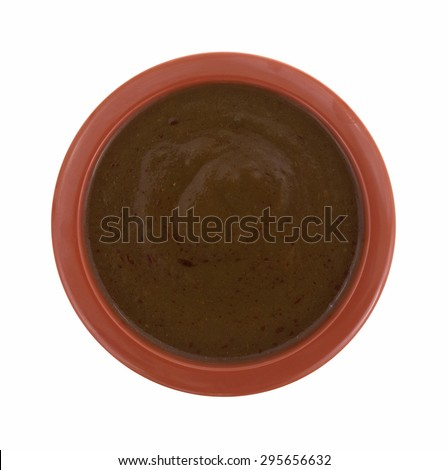 A top view of pizza sauce in a small red bowl on a white background. - stock photo