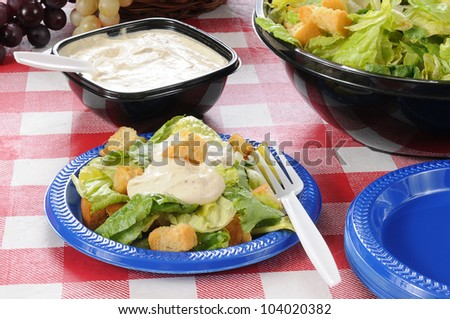 A tossed green salad with ranch dressing and croutons - stock photo