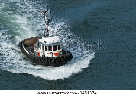 A tough little tugboat. - stock photo