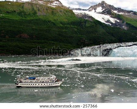 A tour boat approaches Havard Glacier in College Fjord, Alaska. - stock photo