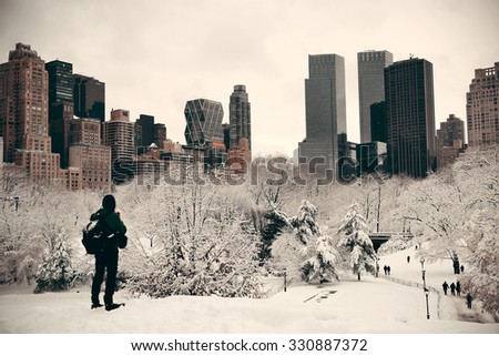 A tourist watching Central Park in midtown Manhattan New York City - stock photo