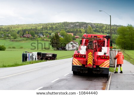 A tow truck arrives on the scene of an accident - stock photo