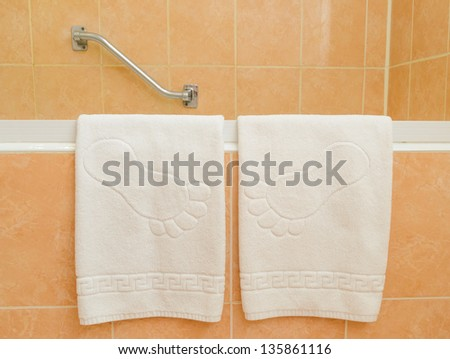 A towel on the rack in the bathroom. microstock photos - stock photo