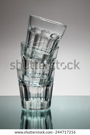 A tower made of empty vodka glasses - stock photo