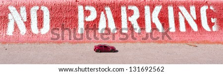 A toy car violating parking laws. - stock photo