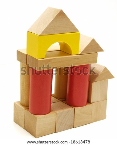 A toy house made from children's  wooden building blocks