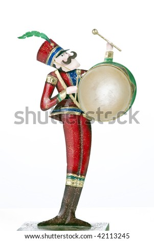 A toy soldier drum player isolated against a white background in the vertical format. - stock photo