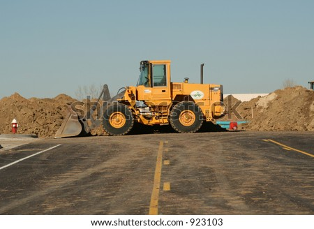 A tractor loader moving dirt - stock photo