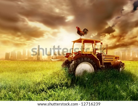 a tractor on the grass field - stock photo